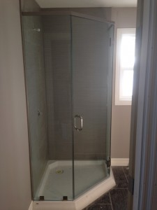 Custom Clear Tempered Frameless shower with Prima Hinges and Header for Guenther Homes, Charlie Lake